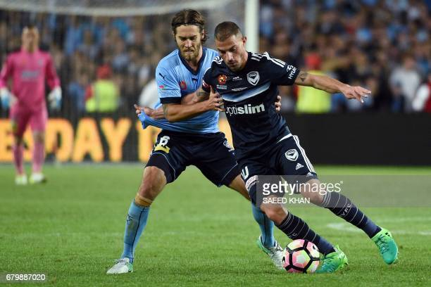 Melbourne Victory's James Troisi fights for the ball with Sydney FC's Joshua Brillante during the 2017 ALeague Grand Final football match at Allianz...