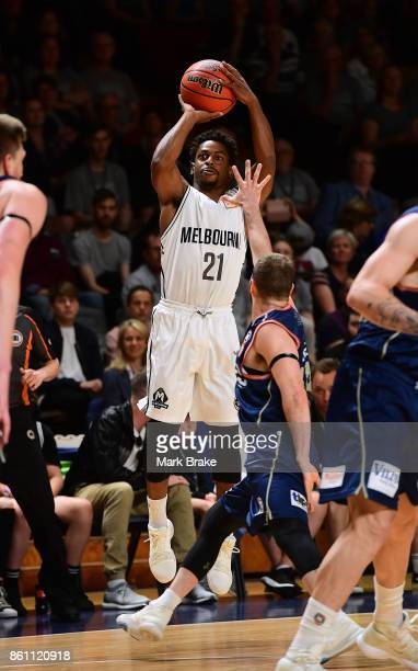 Melbourne's Casper Ware hits three during the round two NBL match between the Adelaide 36ers and Melbourne United at Titanium Security Arena on...