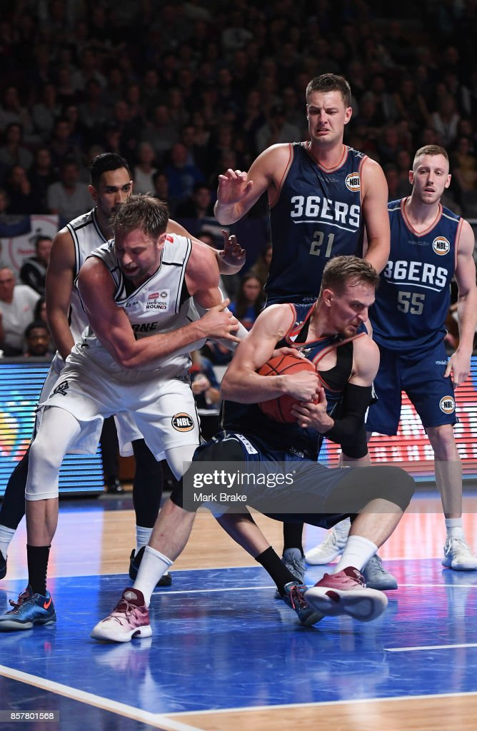 Melbourne's Dave Anderson battles for the ball with Adelaide's Anthony Drmic during the round one NBL match between the Adelaide 36ers and Melbourne UInited at Titanium Security Arena on October 5, 2017 in Adelaide, Australia.