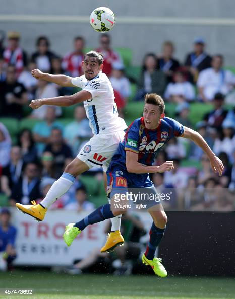Melbournes David Williams and Newcastles Scott Neville during the round two ALeague match between Melbourne City and the Newcastle Jets at AAMI Park...