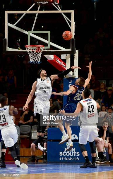 Melbourne's Kyle Adnam blocks Adelaide's Nathan Sobey during the round two NBL match between the Adelaide 36ers and Melbourne United at Titanium...