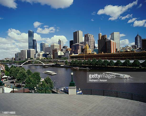 Melbourne's skyline overlooks the historic Flinder's Street Station and Yarra River, and the more recent Southgate shopping and restaurant precinct in the Southbank area.