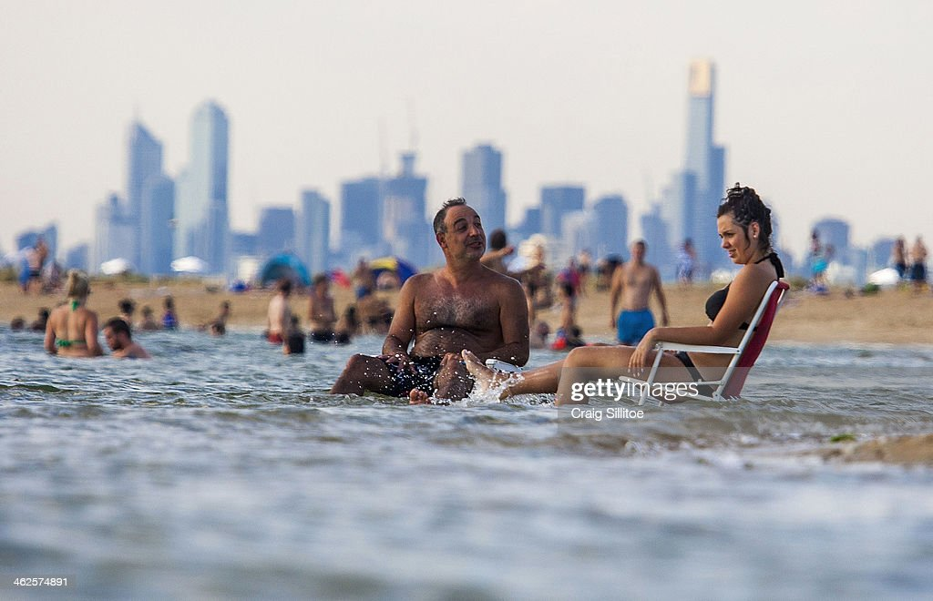 Melburnians keep cool at Brighton Beach on January 14, 2014 in Melbourne, Australia. Temperatures are expected to reach over 40 degrees Celsius in parts of Victoria over the next four days.