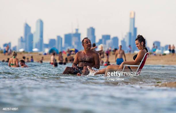 Melburnians keep cool at Brighton Beach on January 14 2014 in Melbourne Australia Temperatures are expected to reach over 40 degrees Celsius in parts...