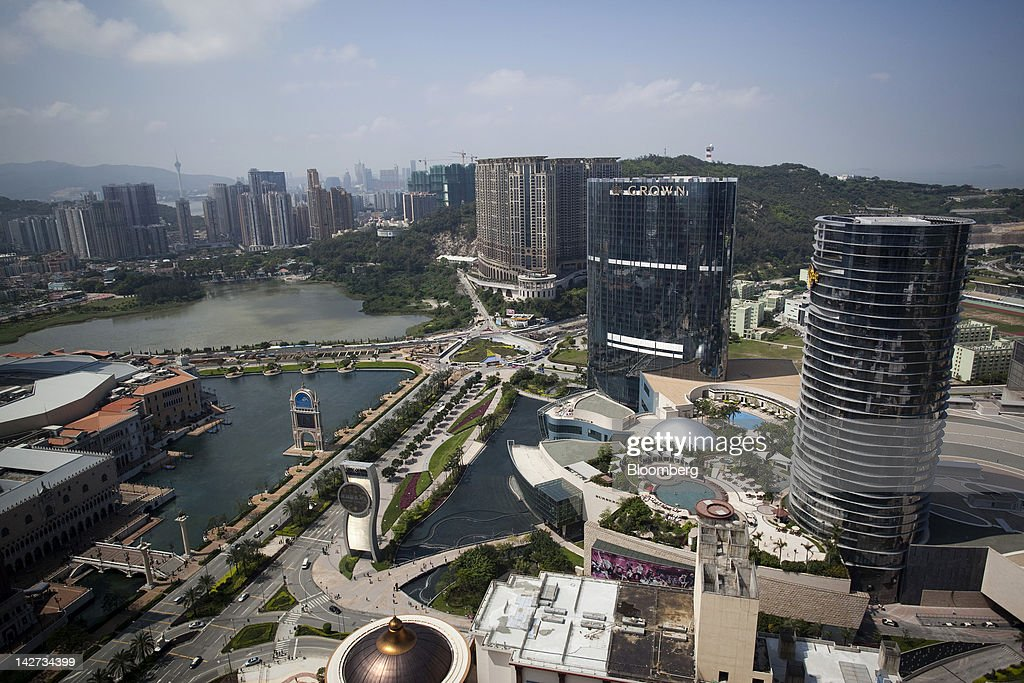 Melco Crown Entertainment Ltd.'s City Of Dreams complex with the Hard Rock Hotel, right, and the Crown Towers Hotel, second right, stand on the Cotai strip in Macau, China, on Wednesday, April 11, 2012. Las Vegas Sands Corp. Chairman Sheldon Adelson plans to spend $35 billion on building Spanish gambling resorts over nine years and will add a new Macau location to expand globally. Photographer: Jerome Favre/Bloomberg via Getty Images