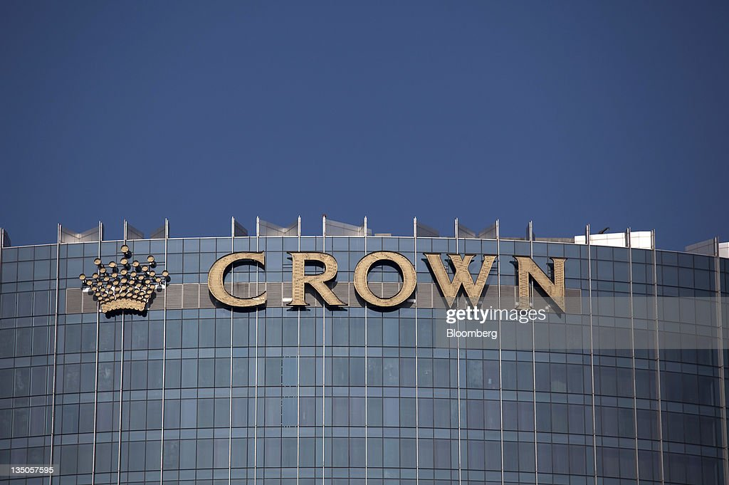 Melco Crown Entertainment Ltd.'s Crown Towers signage sits atop the hotel in Macau, China, on Sunday, Dec. 4, 2011. Macau casino gambling revenue climbed a better-than-expected 33 percent last month as economic growth stoked demand from visitors from China's mainland. Photographer: Jerome Favre/Bloomberg via Getty Images