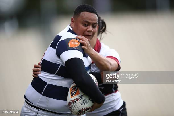 Mele Hufanga of Auckland is tackled during the round five Farah Palmer Cup match between North Harbour and Auckland at QBE Stadium on September 29...
