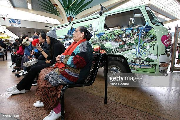Mele Leota watches the entertainment in front of the Love Bus parked in Mangere Town Centre on July 23 2016 in Auckland New Zealand The van is part...