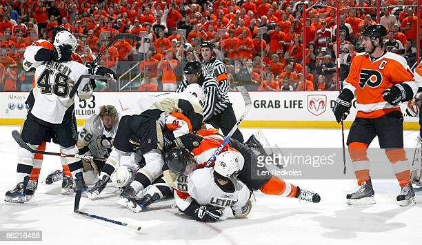 A melee erupts after Ruslan Fedotenko the Pittsburgh Penguins scored a goal in the second period during Game Six of the Eastern Conference...