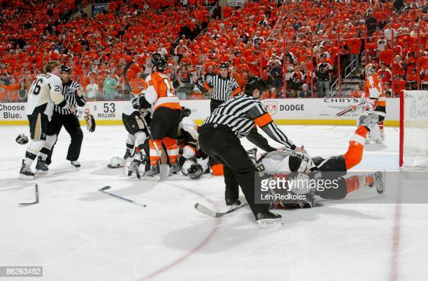 A melee erupts after Ruslan Fedotenko the Pittsburgh Penguins scored a goal in the second period against the Philadelphia Flyers during Game Six of...