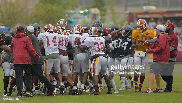 A melee in involving Washington wide receiver Pierre Garcon breaks out during a combined training camp the Washington Redskins held with the Houston...