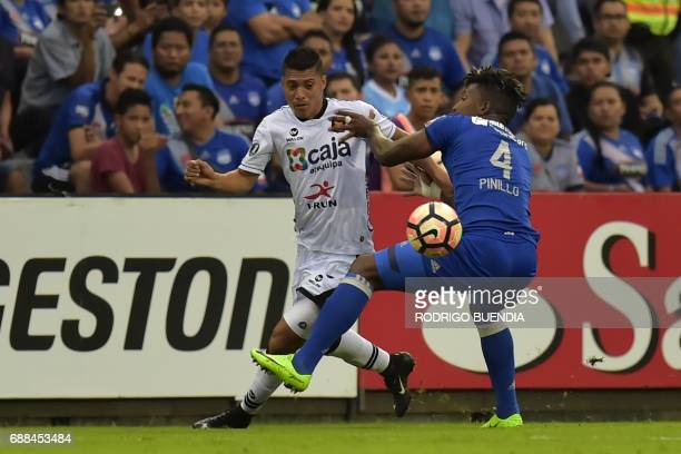 Melgar's Daniel Chavez vies for the ball with Emelec's Fernando Pinillo during their 2017 Copa Libertadores football match at George Capwell stadium...