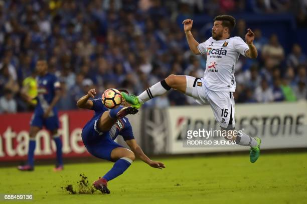 TOPSHOT Melgar's Jean Pierre Barrientos vies for the ball with Emelec's Pedro Quinonez during their 2017 Copa Libertadores football match at George...