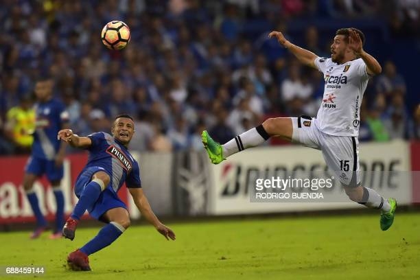 Melgar's Jean Pierre Barrientos vies for the ball with Emelec's Pedro Quinonez during their 2017 Copa Libertadores football match at George Capwell...