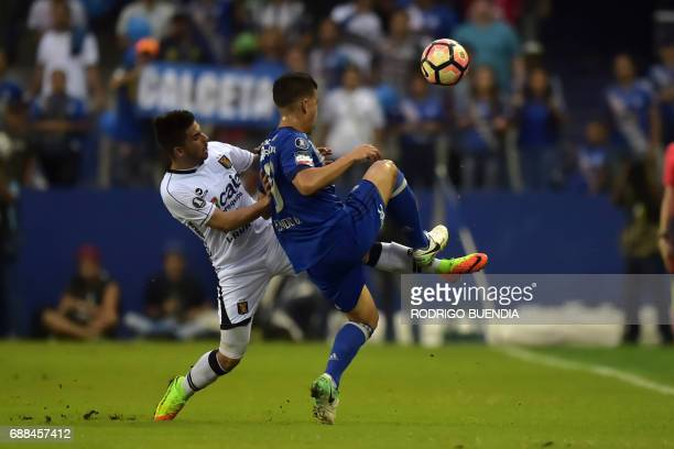 Melgar's Victor Cedron vies for the ball with Emelec's Fernando Gaibor during their 2017 Copa Libertadores football match at George Capwell stadium...