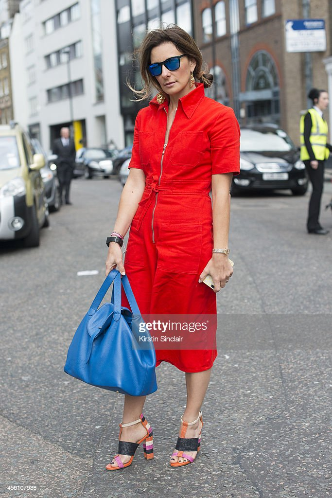 Meli Melo Bag designer Melissa De Bono wears Zara shoes, Meli Melo bag, vintage jumpsuit and Centrostyle sunglasses on day 4 of London Fashion Week Spring/Summer 2013, at Somerset House on September 16, 2013 in London, England.