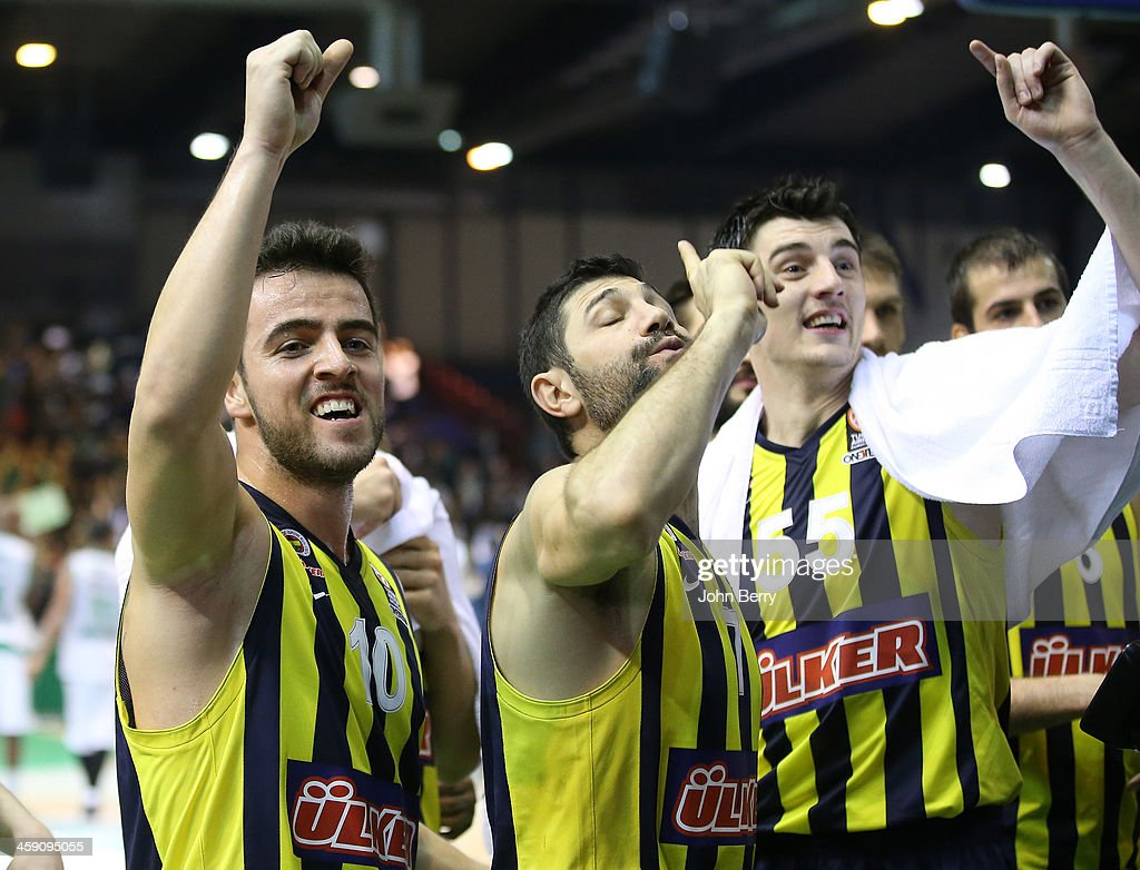 Melih Mahmutoglu, Omer Onan and Emir Preldzic of Fenerbahce celebrate the victory and thank their supporters after the Turkish Airlines Euroleague match between JSF Nanterre and Fenerbahce Ulker Istanbul at the Halle Carpentier on December 19, 2013 in Paris, France.