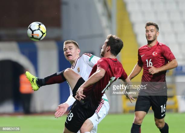 Melih Okutan of Turkey in action against Attila Szalai of Hungary during the 2017 UEFA European Under21 Championship qualification Group 6 football...