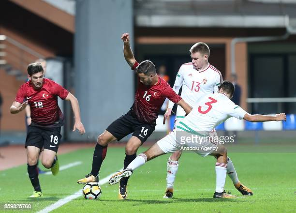 Melih Okutan Ogulcan Caglayan of Turkey in action against Bence Toth of Hungary during the 2017 UEFA European Under21 Championship qualification...