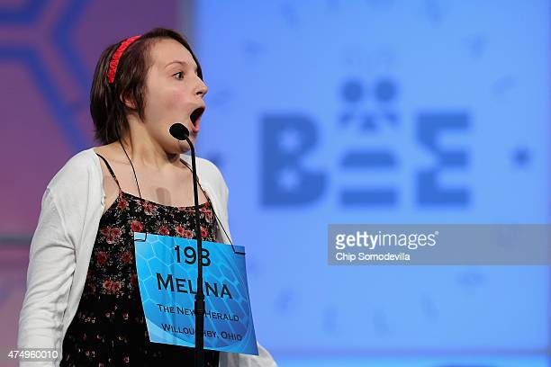 Melina Gabele of Willoughby Ohio reacts after correctly spelling her word during the 88th Scripps National Spelling Bee semifinals at the Gaylord...