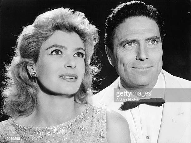 Melina Mercouri and Raf Vallone looking up in a scene from the film 'Phaedra' 1962