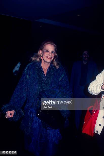 Melina Mercouri in a blue and gray wool coat with fringe circa 1970 New York