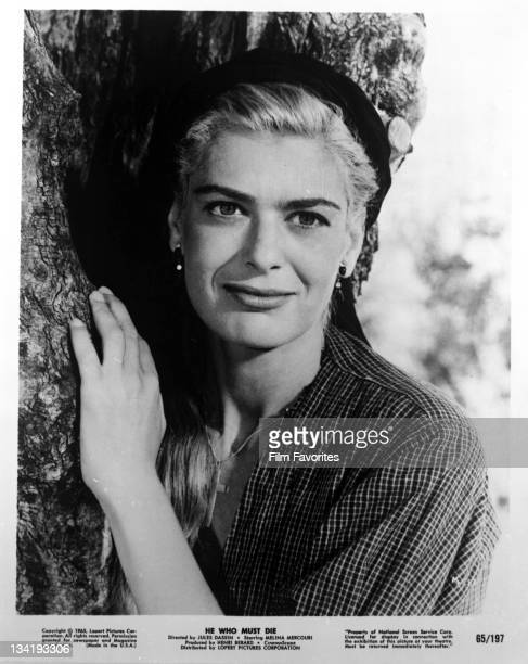 Melina Mercouri leaning against tree in a scene for the film 'He Who Must Die' 1957