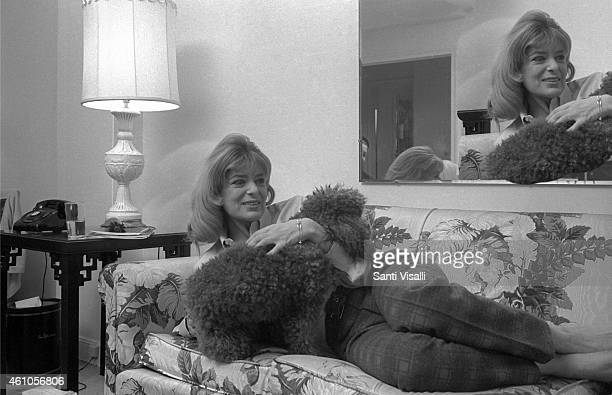 Melina Mercouri posing for a photo with her dog on December 15 1967 in New York New York