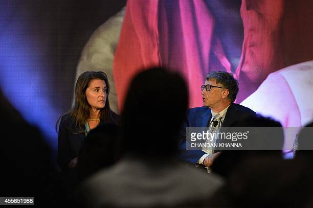Melinda and Bill Gates of the Bill Melinda Gates Foundation gesture during a conversation with Indian author Chetan Bhagat at an 'All Lives Have...