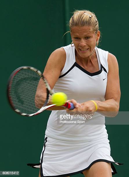 Melinda Czink of Hungary in action during her third round match against Shuai Peng of China on Day Six of the Wimbledon Lawn Tennis Championships at...