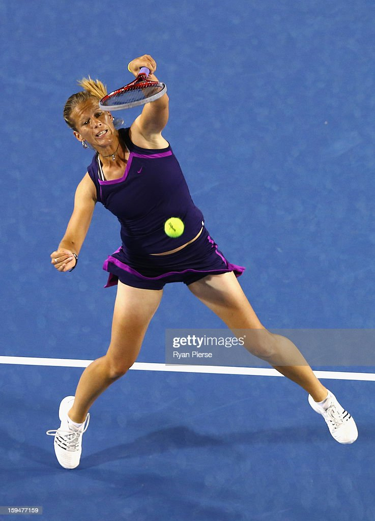 Melinda Czink of Hungary plays a smash during her first round match against Ana Ivanovic of Serbia during day one of the 2013 Australian Open at Melbourne Park on January 14, 2013 in Melbourne, Australia.