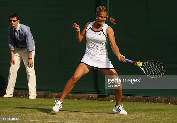Melinda Czink of Hungary returns a shot during her first round match against Samantha Stosur of Australia on Day Two of the Wimbledon Lawn Tennis...