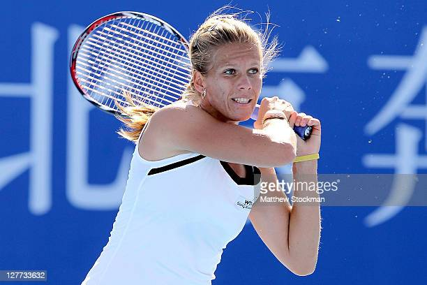 Melinda Czink of Hungary returns a shot to Laura Robson of Great Britain during the China Open at the National Tennis Center on October 1 2011 in...