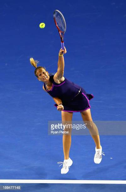 Melinda Czink of Hungary serves during her first round match against Ana Ivanovic of Serbia during day one of the 2013 Australian Open at Melbourne...