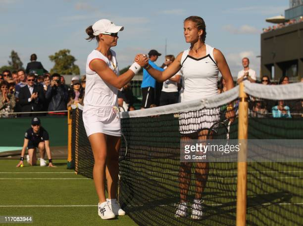 Melinda Czink of Hungary shakes hands with Samantha Stosur of Australia after winning her first round match on Day Two of the Wimbledon Lawn Tennis...