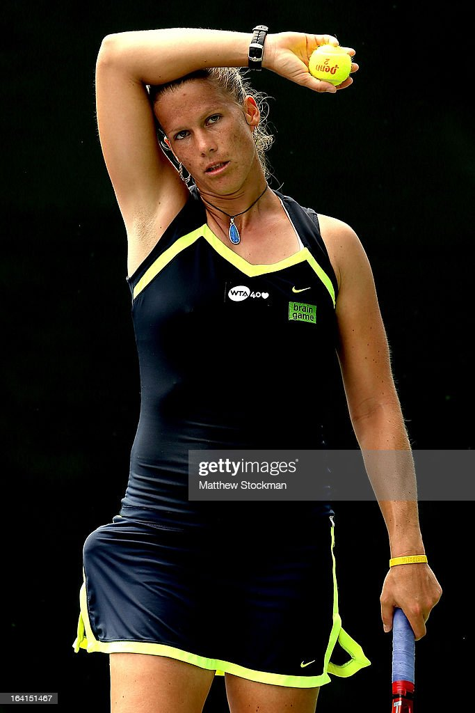 Melinda Czink of Hungary wipes her forehead between points while playing Olga Govortsova of Belarus during the Sony Open at Crandon Park Tennis Center on March 20, 2013 in Key Biscayne, Florida.