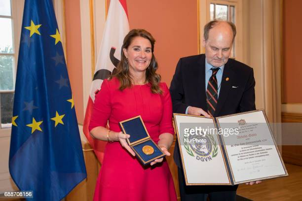 Melinda Gates poses for a picture with journalist Dietrich Hahn after being awarded with the OttoHahn Peace Medal at the town hall in Berlin Germany...