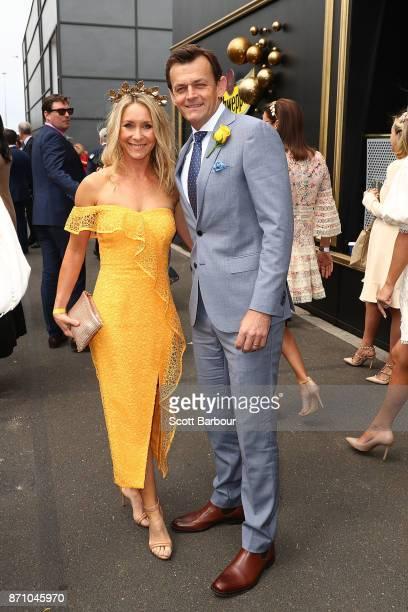 Melinda Gilchrist and Adam Gilchrist pose at the on Melbourne Cup Day at Flemington Racecourse on November 7 2017 in Melbourne Australia