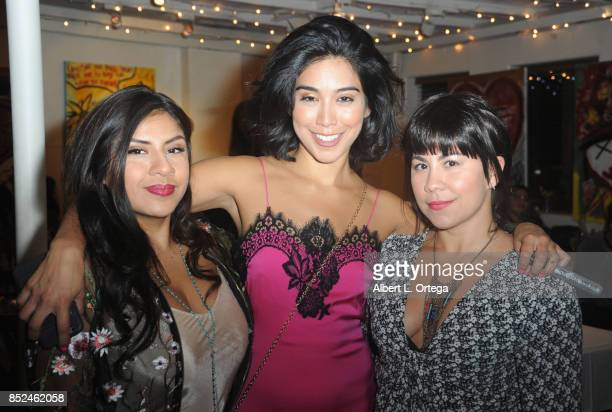 Melinna Bobadilla Vanessa E Garcia and Santana Dempsey attend the Vanessa E Garcia's Art Show with partial proceeds going to House of Ruth based in...