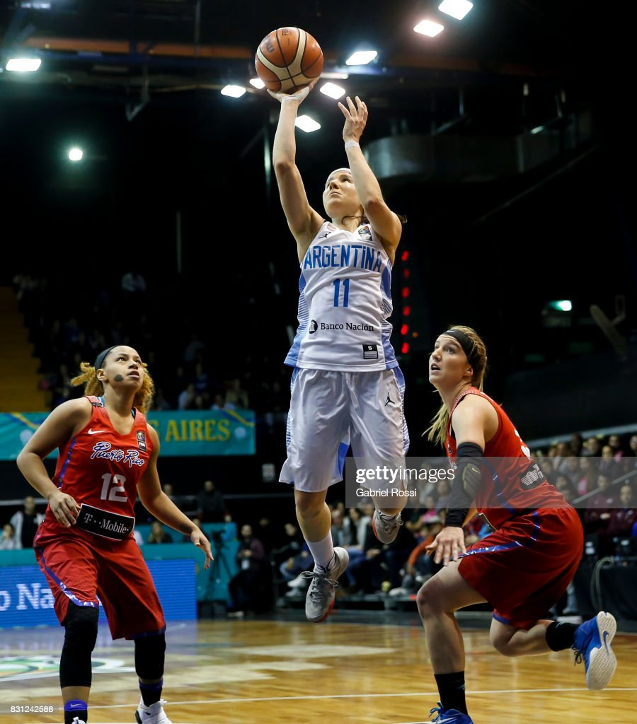 Melisa Gretter of Argentina jumps for a throw of Puerto Rico during a match between Argentina and Puerto Rico as part of the FIBA Women's AmeriCup Semi Final at Obras Sanitarias Stadium on August 12, 2017 in Buenos Aires, Argentina.