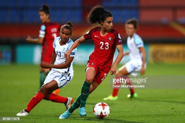 Melissa Antunes of Portugal holds off pressure from Nikita Parris of England during the UEFA Women's Euro 2017 Group D match between Portugal and...