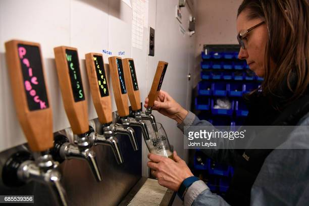 Melissa Arp pours herself a Pilsner in the tasting room at then Sandlot Brewery at Coors Field The tie between beer and baseball and how Coors Field...