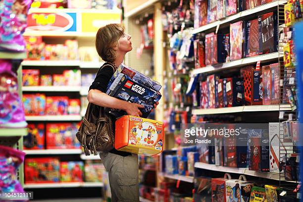 Melissa Brunschwig shops for toys at the Toys'R'Us store on September 28 2010 in Miami Florida Toys'R'Us announced today it will hire about 45000...