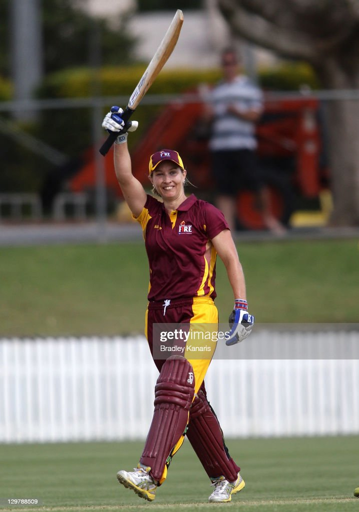 Melissa Bulow of the Fire celebrates scoring a century during the Women's Twenty20 match between the Queensland Fire and the Tasmania Roar at Allan...