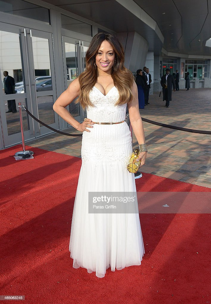 <a gi-track='captionPersonalityLinkClicked' href=/galleries/search?phrase=Melissa+De+Sousa&family=editorial&specificpeople=2982665 ng-click='$event.stopPropagation()'>Melissa De Sousa</a> arrives at the 2014 Trumpet Awards at Cobb Energy Performing Arts Center on January 25, 2014 in Atlanta, Georgia.