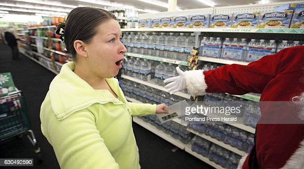 Melissa Delafontaine of Sanford reacts with disbelief after realizing Secret Santa Maine just handed her a $100 bill at the Dollar Tree