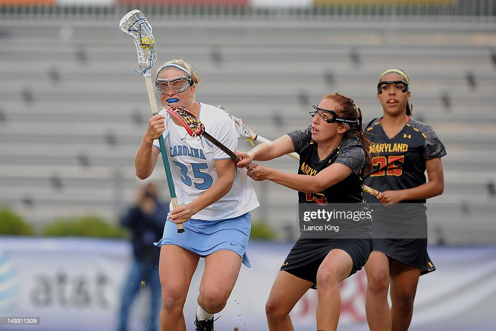 Melissa Diepold #15 of the Maryland Terrapins defends Brittney Coppa #35 of the North Carolina Tar Heels during the finals of the 2012 Women's ACC Tournament at Koskinen Stadium on April 23, 2012 in Durham, North Carolina.