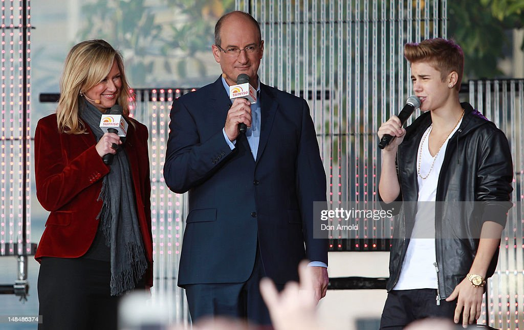 Melissa Doyle and David Koch introduce Justin Bieber during his performance on the Sunrise program at The Overseas Passenger Terminal on July 18, 2012 in Sydney, Australia.