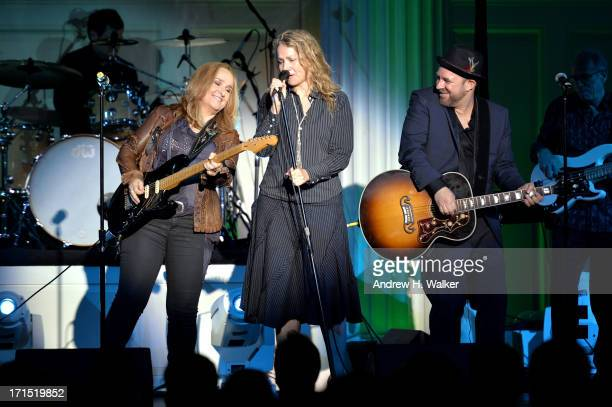 Melissa Etheridge Joan Osborne and Kristian Bush perform at The Recording Academy Honors at 583 Park Avenue on June 25 2013 in New York City