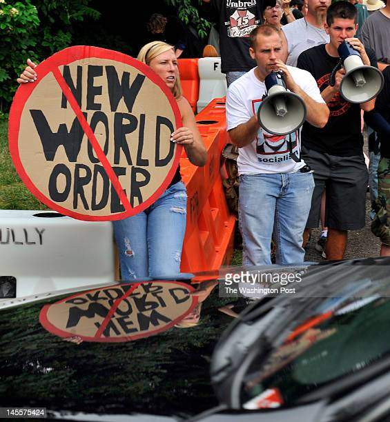 Melissa Faust Adam Stevens and Jeff Durkin let their feelings known to a vehicle entering the Westfields Marriott for the secretive Bilderberg...
